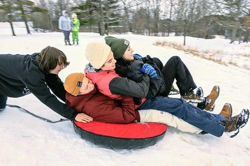 Rock Point School students sledding in winter