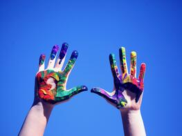 person-s-hands-with-paint-1428171